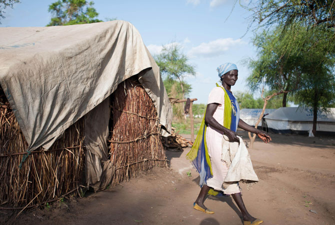 A refugee from Blue Nile exits what has been her home for the past 3 months, in Doro refugee camp, Upper Nile State, South Sudan. ? Photo by AFP