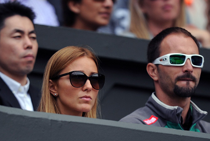 Jelena Ristic (2nd L), partner of Serbian player Novak Djokovic, watches his first round men's singles victory over Spain's Juan Carlos Ferrero on the first day of the 2012 Wimbledon Championships tennis tournament at the All England Tennis Club in Wimbledon, southwest London, on June 25, 2012. ? AFP Photo