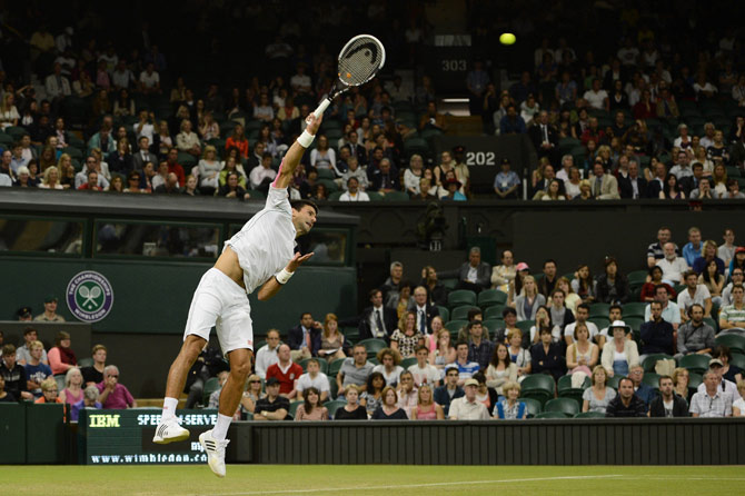 Serbia's Novak Djokovic serves during his second round men's singles victory over US player Ryan Harrison. – Photo by AFP