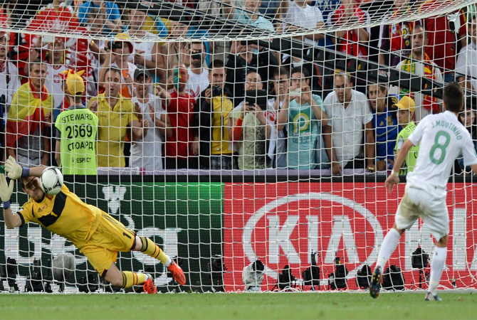 Portuguese midfielder Joao Moutinho kicks a penalty shoot-out against Spanish goalkeeper Iker Casillas. ? Photo by AFP
