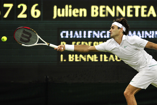 Switzerland's Roger Federer streches to reach the ball during his third round men's singles match against France's Julien Benneteau. ? Photo by AFP
