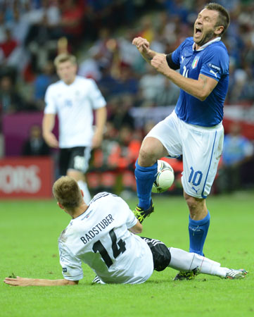 Italian forward Antonio Cassano vies with German defender Holger Badstuber during the Euro 2012 football championships semi-final match.