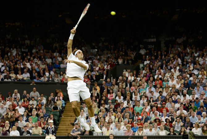 Roger Federer of Switzerland serves to Julien Benneteau of France during their men's singles match. ? Photo by Reuters