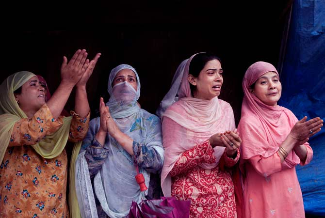 Kashmiri women wail outside the nearly 200-years-old Sheikh Abdul Qadir Jeelani Shrine, popularly known worldwide as Ghaus-e-Azam or Dastgeer Sahab after it caught fire in downtown Srinagar, India, Monday, June 25, 2012. — AP Photo