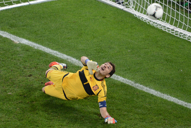 Spanish goalkeeper Iker Casillas jumps for the ball during the penalty shoot-out at the end of the Euro 2012 semi-finals. ? Photo by AFP