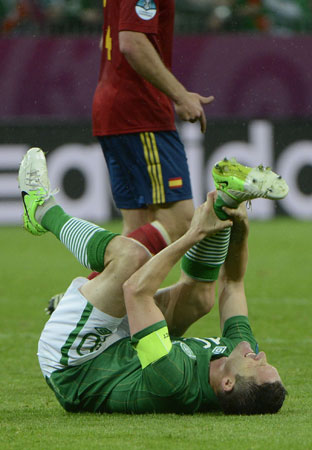Irish forward Robbie Keane holds his leg after being fouled during the Euro 2012 championships football match Spain vs Republic of Ireland on June 14, 2012 at the Gdansk Arena. ? Photo by AFP