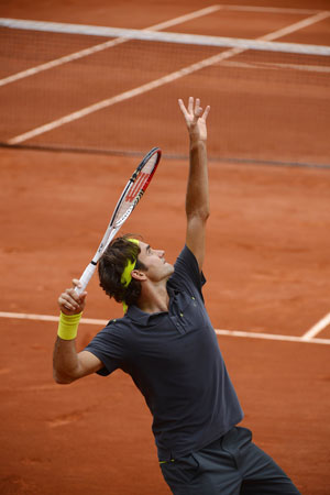Switzerland's Roger Federer serves to Argentina's Juan Martin Del Potro during their Men's Singles Quaterfinals match of the French Open. ? Photo by AFP