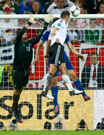 Germany's Miroslav Klose (Right) scores their third goal during their Euro 2012 quarter-final soccer match against Greece.