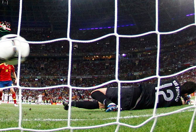 Spain's Cesc Fabregas (Left) scores the winning penalty goal against Portugal's goalkeeper Rui Patricio during the penalty shoot-out in their Euro 2012 semi-finals. ? Photo by Reuters