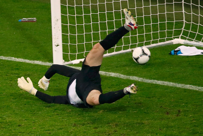 Ireland's goalkeeper Shay Given fails to save a goal by Spain's David Silva (not pictured) during their Group C Euro 2012 football match. ? Photo by Reuters