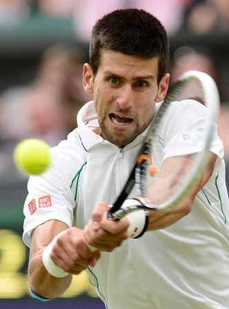 Novak Djokovic of Serbia hits a return to Radek Stepanek of the Czech Republic. ? Photo by Reuters