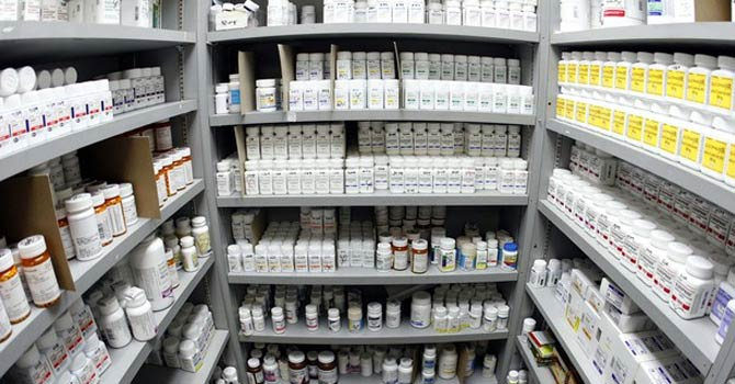 Pills line the shelves in the pharmacy at Venice Family Clinic in Los Angeles. – Reuters