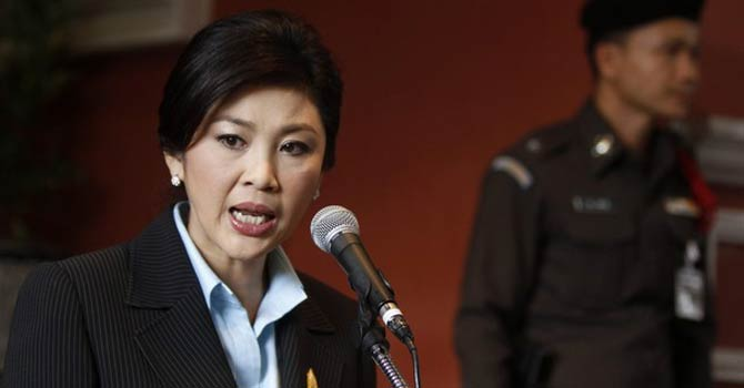 Thailand's Prime Minister Yingluck Shinawatra speaks during a news conference after a weekly cabinet meeting at the Government House in Bangkok. NASA's request to use U-Tapao airbase to conduct regional climate studies drew staunch criticism from Thailand's main opposition party who say granting the U.S use of the base amounts to Thailand losing its sovereignty. – Reuters
