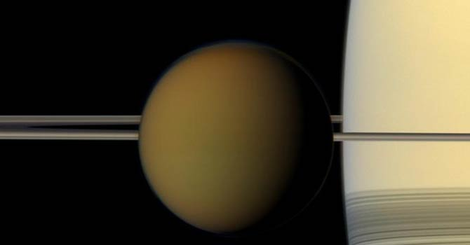 This undated true color image by the Cassini spacecraft released by Nasa shows Saturn's largest moon, Titan, passing in front of the planet and its rings. – AP