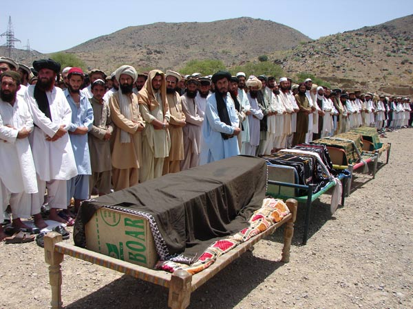 In this Thursday, June 16, 2011 file photo, villagers offer funeral prayers for people who were reportedly killed by a U.S. drone attack in Miranshah, capital of North Waziristan along the Afghanistan border. – Photo by AP