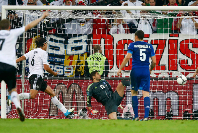 Germany's Sami Khedira scores a goal during the Euro 2012 quarter-final match against Greece.