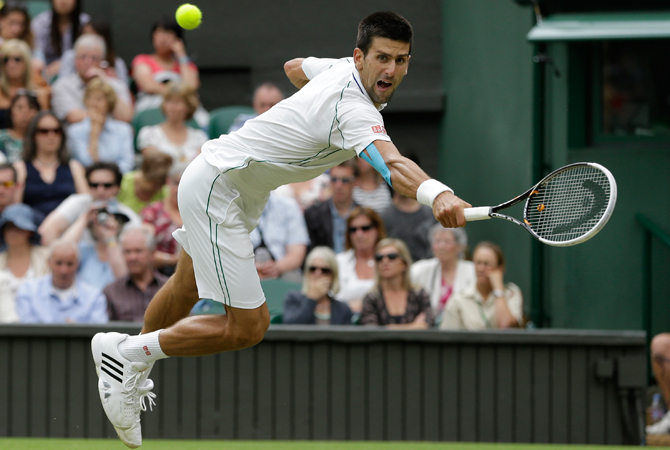 Novak Djokovic of Serbia reaches for a shot by Radek Stepanek of the Czech Republic. ? Photo by AP