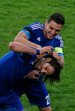 Greece's Giorgos Samaras (front) celebrates with Kostas Katsouranis after scoring a goal against Germany during their Euro 2012 quarter-final match.