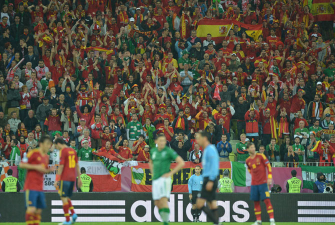 Spanish supporters cheer their team during the Euro 2012 championships football match Spain vs Republic of Ireland at the Gdansk Arena. ? Photo by AFP