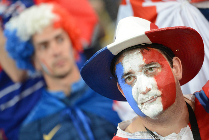 A French fan reacts at the end of the Euro 2012 football championships quarter-final match Spain vs France. ? Photo by AFP