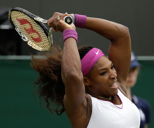 Serena Williams of the United States returns a shot to Barbora Zahlavova Strycova of the Czech Republic during a first round women's singles match. ? Photo by AP