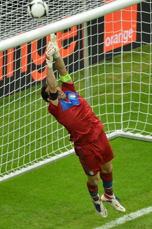 Italian goalkeeper Gianluigi Buffon jumps for the ball during semi-final match.