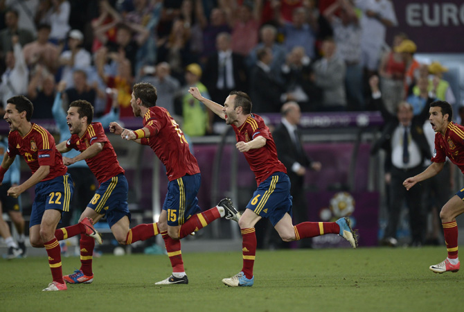 Spanish players celebrate after winning the Euro 2012 football semi-finals. ? Photo by AFP