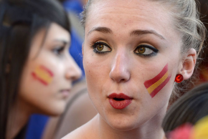 A supporter of the Spanish national football team reacts as she watches the Euro 2012 football championships match between Spain and Ireland. ? Photo by AFP