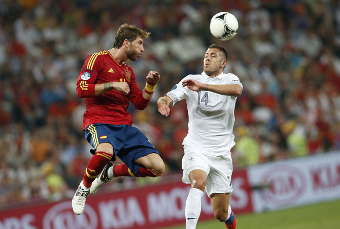 Spain's Sergio Ramos (L) heads the ball against France's Jeremy Menez during their Euro 2012 quarter-final. ? Photo by Reuters