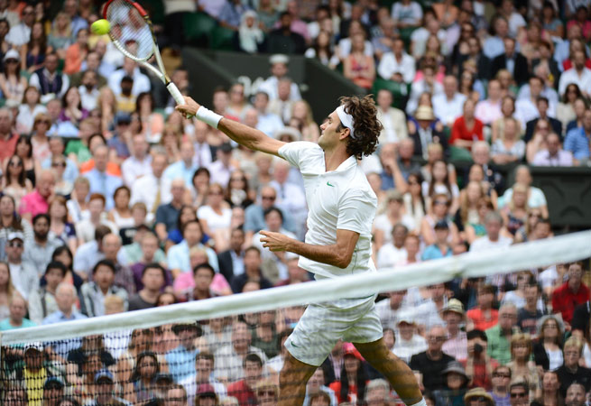 Switzerland's Roger Federer plays a volley during his second round men's singles victory over Italy's Fabio Fognini. – Photo by AFP
