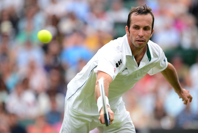 Czech Republic's Radek Stepanek plays a backhand shot during his third round men's singles match against Serbia's Novak Djokovic on day five of the 2012 Wimbledon Championships. ? Photo by AFP