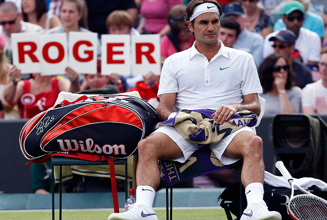 Roger Federer of Switzerland sits on his seat during his men's singles tennis match against Albert Ramos of Spain at the Wimbledon tennis championships in London June 25, 2012. ? Reuters Photo