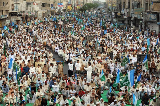 Supporters of Jammat-e-Islami (JI) gather for a protest in Karachi on June 10, 2012, against the Pakistani government's plan to reopen NATO supplies route to Afghanistan. – Photo by AFP