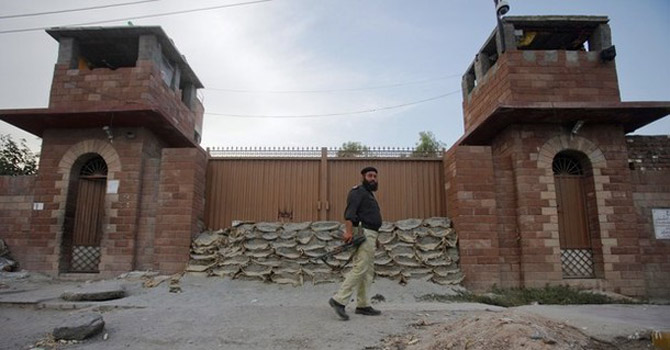 A police officer walks past Central Jail in Peshawar.—Reuters Photo