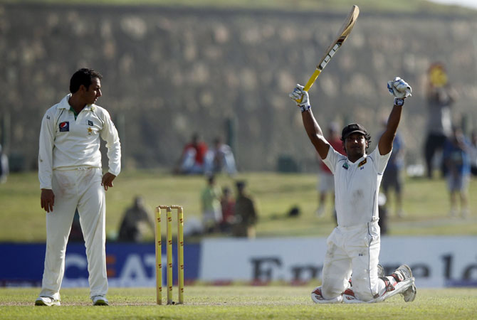 Sangakkara continued Dilshan's good work as he moved to his 29th Test hundred with a risky single to mid-off for which he had to dive full-length to make his ground. -Photo by Reuters