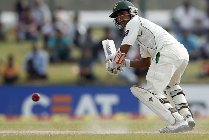Pakistan's wicket-keeper Adnan Akmal offered resistance lower down the order and was unbeaten on 40 when his side were bowled out for 300. -Photo by Reuters