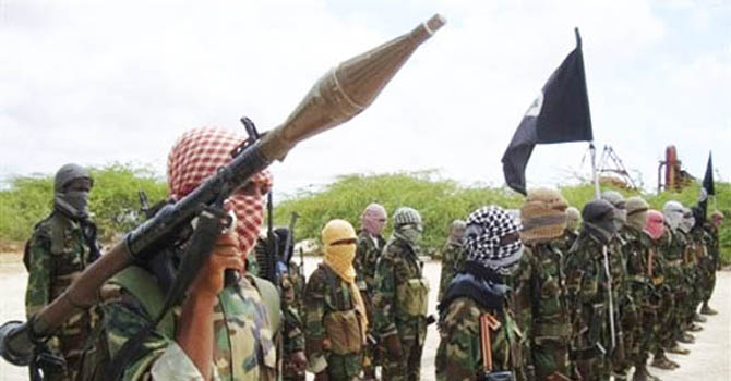Al-Shabaab fighters display weapons as they conduct military exercises in northern Mogadishu, Somalia, Thursday, Oct. 21, 2010, (AP Photo/Farah Abdi Wa
