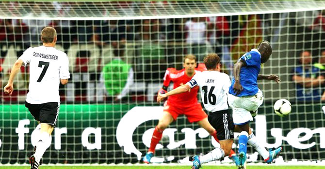 Mario Balotelli scores his second goal of the match against Germany- AFP Photo
