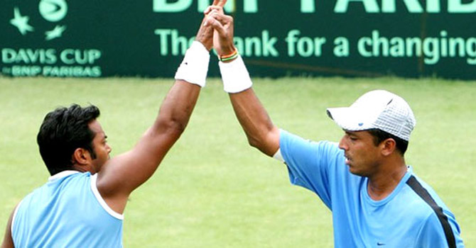 Mahesh Bhupathi with Leander Paes.—File Photo
