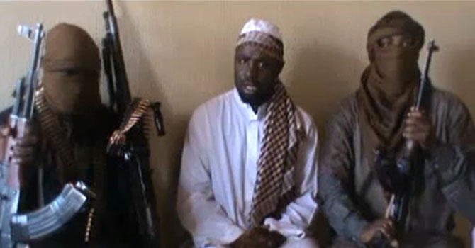"A file screengrab taken from a video released on You Tube on April 12, 2012 apparently shows Boko Haram leader Abubakar Shekau (C) sitting flanked by militants. Boko Haram Islamists on June 18, 2012 claimed suicide attacks on three churches in northern Nigeria's Kaduna state that killed at least 16 and sparked riots that killed dozens more.  AFP PHOTO / YOUTUBE  == RESTRICTED TO EDITORIAL USE - MANDATORY CREDIT ""AFP PHOTO / YOUTUBE"" - NO MARKETING NO ADVERTISING CAMPAIGNS - DISTRIBUTED AS A SERVICE TO CLIENTS =="