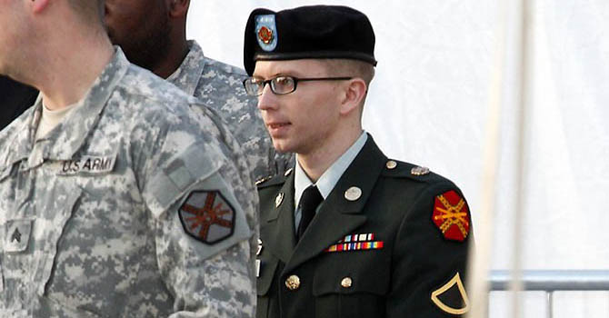 Army Pfc. Bradley Manning, in handcuffs, is escorted out of a courthouse in Fort Meade, Maryland February 23, 2012. Manning, a U.S. Army intelligence analyst accused of the largest leak of classified documents in U.S. history, deferred pleading guilty or not guilty in a military court arraignment on Thursday, marking the first step in a court martial that could land him imprisonment for life. REUTERS/Jose Luis Magana (UNITED STATES - Tags: MILITARY CRIME LAW)