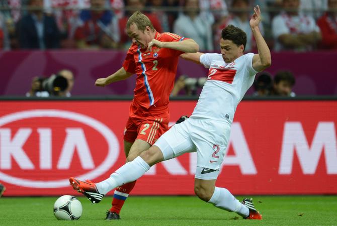 Polish defender Sebastian Boenisch vies with Russian defender Aleksander Anyukov.
