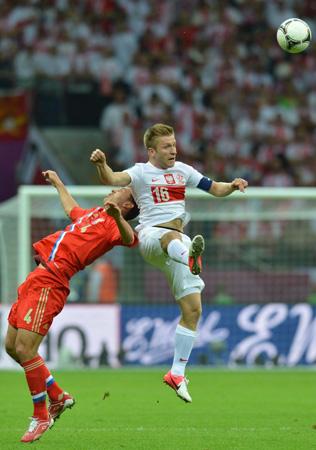 Russian defender Sergey Ignashevich vies with Polish midfielder Jakub Blaszczykowski.
