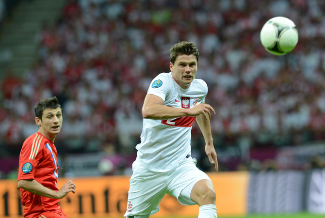 Polish defender Sebastian Boenisch eyes the ball.