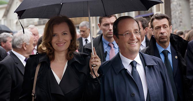 French President Francois Hollande and his companion Valerie Trierweiler  take part in a march as part of a ceremony in tribute to the memory of Nazi victims in Tulle, southwestern France, on Saturday,  June 9, 2012. On June 9, 1944, 99 hostages were hanged from lampposts and balconies by the SS Division Das Reich in Tulle. (AP Photo/Bertrand Langlois, Pool)
