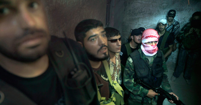 Fighters with the Free Syria Army gather at an undisclosed location. — Photo by AFP