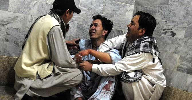 Men belonging to the Hazara community mourn the killing of their relatives at a hospital in Quetta on April 9, 2012, following an attack by gunmen. — File photo by AFP