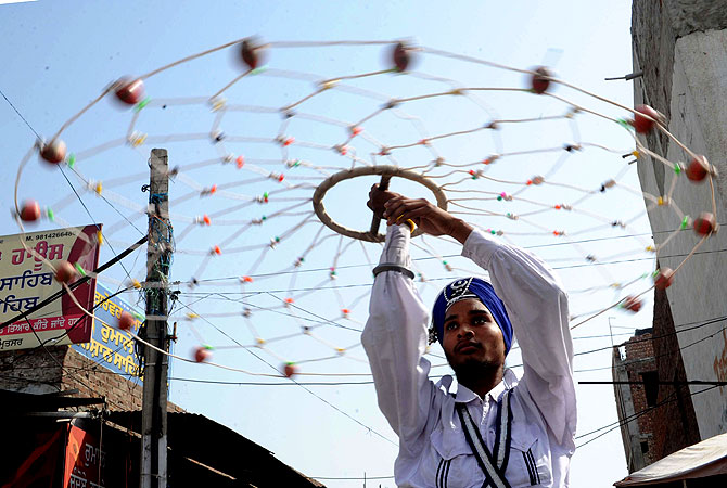 Indian Nihang, a religious Sikh warrior, preforms Gatka, a Sikh martial art, during a procession from the Gurudwara Shaheed Baba Deep Singh temple to the Gurudwara Lohgarh Sahib temple in Amritsar. -Photo by AFP
