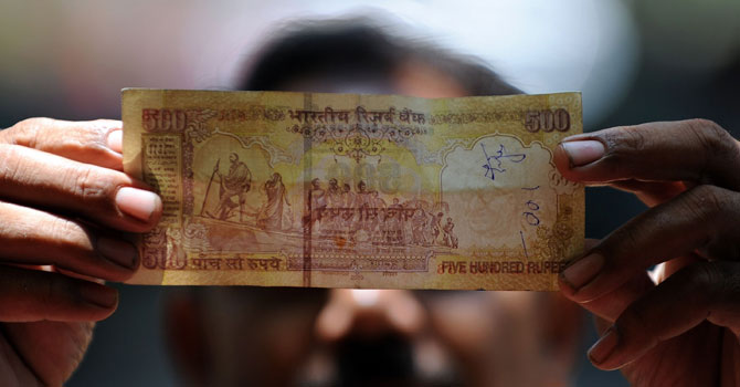 The photo shows an Indian bank note. - File Photo