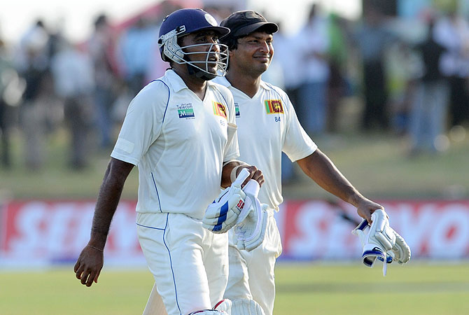 Kumar Sangakkara (R) and Mahela Jayawardene leave the ground at close of play. -Photo by AFP